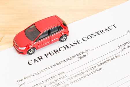 indenture: Car purchase contract with red car on left view. Auto purchase agreement or legal document