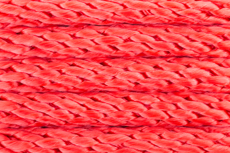 Red Nylon Rope Background for Design. Nylon rope background in close up view.