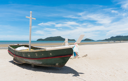 Fishing boat or fisherman boat or ship on Sam Roi Yod bech Prachuap Khiri Khan Thailand with blue sky and cloud and blue sea and mountain or hill. Landscape or scenery for summer season concept