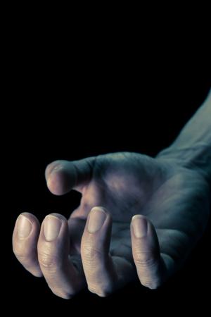Vintage Upturned Human Hand for Devil Crime Violence Concept in Book Cover Style. Upturned Human Hand Portrait View for Devil Crime Violence Concept