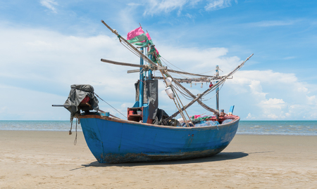 Blue fishing boat or fisherman boat or ship on Sam Roi Yod bech Prachuap Khiri Khan Thailand with blue sky and cloud and blue sea. Landscape or scenery for summer season concept Фото со стока