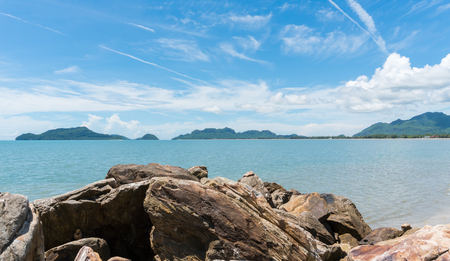 Scenery or landscape of the beach at Prachuap Khiri Khan Thailand. Sea or brine and rock or stone and blue sky and green tree mountain.  Summer concept in relaxation mood for design