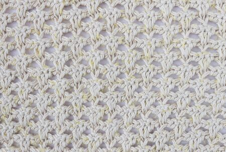 Yellow Knitting Pattern or Knitted Pattern Background in macro style. Knitting Pattern or Knitted Pattern in vintage style for design