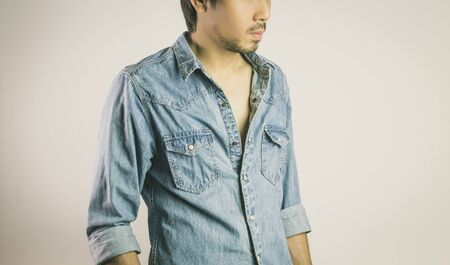 Jeans Shirt or Denim Shirt Man Fashion in 45 degree View. Jeans shirt or denim shirt fashion for men on grey background