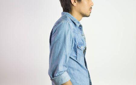 Portrait Man in Jeans Shirt or Denim Shirt Fashion in Side View. Jeans shirt or denim shirt fashion for men on grey background