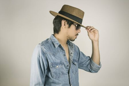 Portrait Man in Jeans Shirt or Denim Shirt and Glasses or Eye wear and Touch Hat.