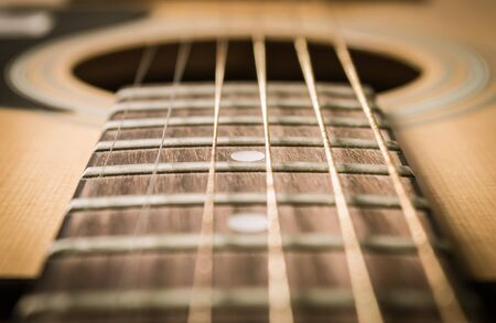 Close Up Fingerboard and Inlay of 6 String Brown Wood Acoustic Guitar Stock Photo