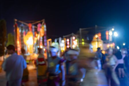 Blurred Lights and Blurred People at Foreground in Loi Krathong Festival at Phayao Thailand
