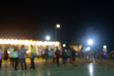 Blurred Lights and Blurred People in Loi Krathong Festival at Phayao Thailand in Medium Shot