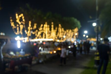 Blurred Lights and Blurred People in Loi Krathong Festival Thailand in Medium Shot