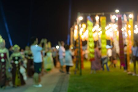 Zoom Blurred Lights and Blurred People in Loi Krathong Festival at Phayao Thailand