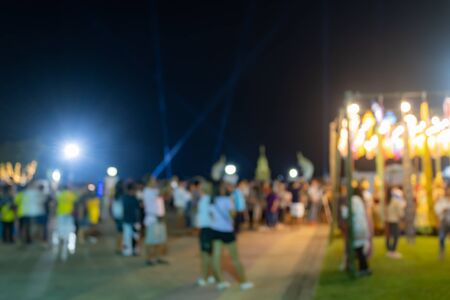 Yellow Blurred Lights and Blurred People in Loi Krathong Festival at Phayao Thailand Banco de Imagens