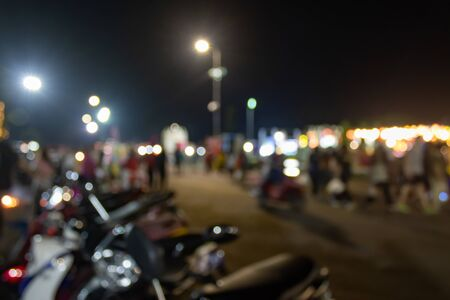 Blurred Motorcycle and Blurred People or Crowd in Loi Krathong Festival at Phayao Thailand