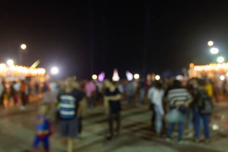 Blurred Crowd on Street and Light on Night Time. Crowd blurred focus in standing posture with colorful light
