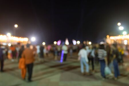 Blurred Crowd and Light in Night Scene. Crowd blurred focus in standing posture with colorful light