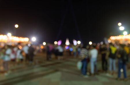 Blurred Crowd on Street and Light in Night Scene. Crowd blurred focus in standing posture with colorful light