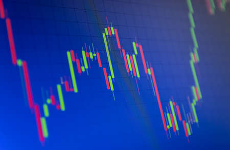 Tilted Red and Green Stock Chart or Forex Chart and Table Line on Blue Background