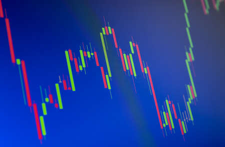 Tilted Red and Green Stock Chart or Forex Chart on Blue Background Banco de Imagens