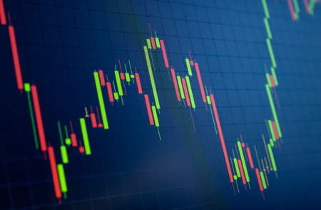 Tilted Red and Green Stock Chart or Forex Chart and Table Line on Black Background