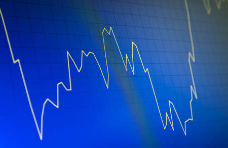 Tilted Yellow Stock Chart or Forex Chart and Table Line on Blue Background on Unstable Trend