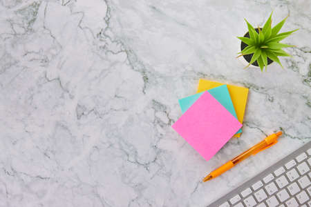 Tree Color Stick Note or Notepad and Computer Keyboard and Office Plant and Pen on Modern Clean Marble Office Desk or Office Table Background