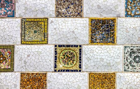 close up detail of a Geometric mosaic of ceramic tile by Antoni Gaudi at his Parc Guell, Barcelona, Spain Imagens