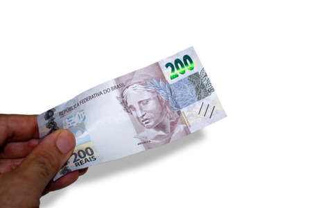 Hand holding a brazilian money two hundred real bill