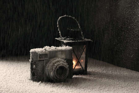 snowing: Old camera even under the heavy snowing. Stock Photo