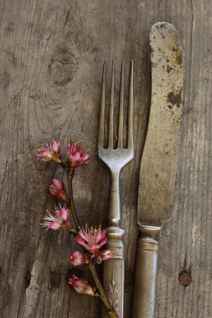 Old stylish flatware with flowers.