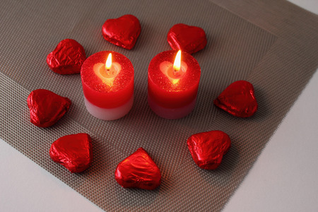 Two candle with sweet hearts Stock Photo