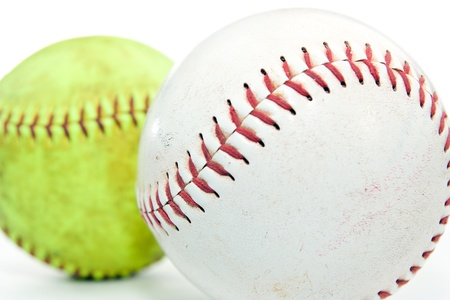 scuffed: Two colored softballs on white background Stock Photo