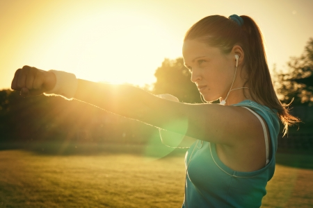 Young woman do sport on a play-ground Stock Photo