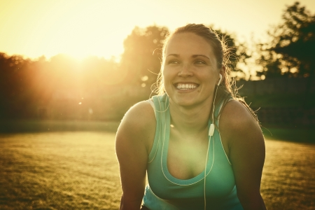 Beautiful young woman is tired from a run