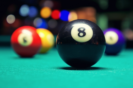 billiards hall: A Vintage style photo from a billiard balls in a pool table  Noise added for a film effect Stock Photo