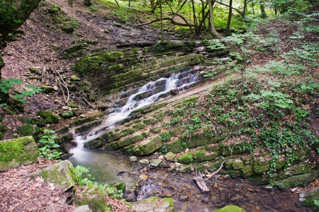 This mini waterfall was photographed in a place named Obanya  It is a nature reserve in Hungary, the county of Baranya, Mecsek mountain