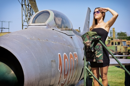 female soldier: Beautiful young woman salute to the veteran fighter bomber