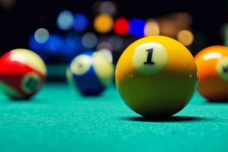 A Vintage style photo from a billiard balls in a pool table  Noise added for a film effect Banque d'images