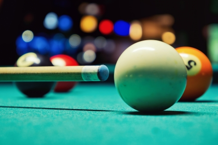 cue sports: A Vintage style photo from a billiard balls in a pool table  Noise added for a film effect Stock Photo