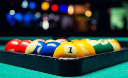 A Vintage style photo from a billiard balls in a pool table  Noise added for a film effect Standard-Bild