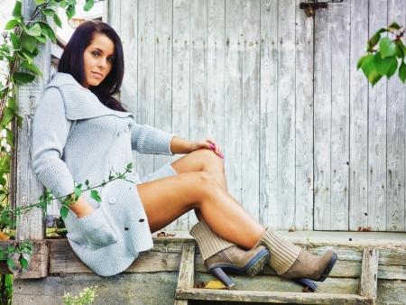 women in boots: Sexy women sitting on a old veranda