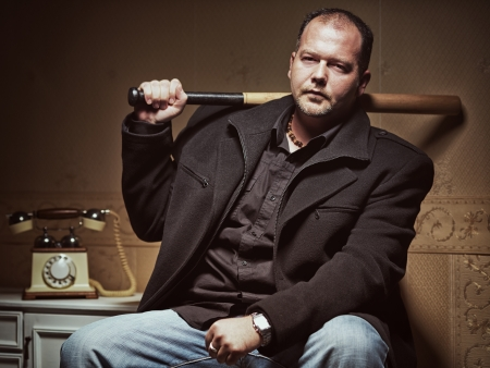 bad guy: Vintage style photo from a bad guy with a baseball bat