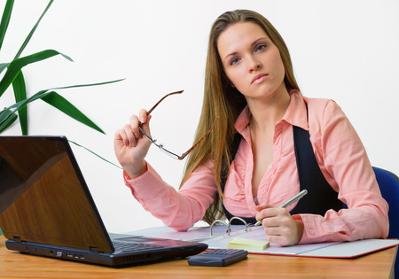 stringent: Beautiful young office worker looking stringent Stock Photo