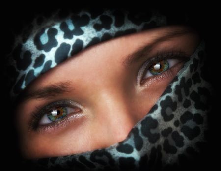 kerchief: Young women cover her face with a headscarf