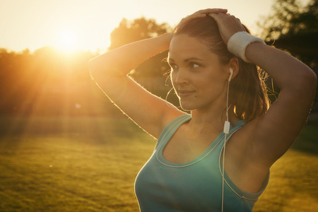 Vintage style photo from a young woman is tired after run Standard-Bild