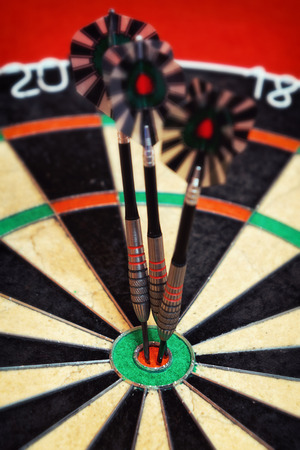 bull     s eye: Vintage style photo from three darts hit the double Bull s-Eye