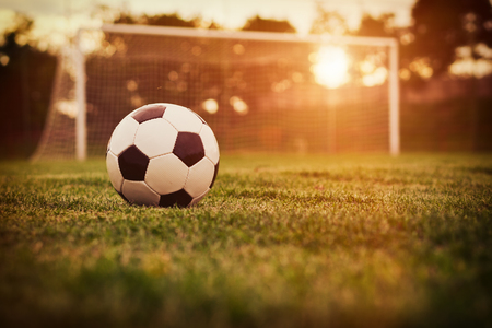 Soccer in the sunset Banque d'images