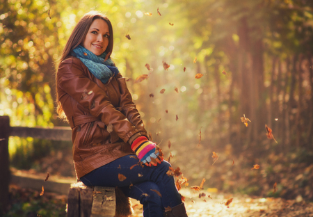 retro woman: Young women in the forest with warm, autumn fashioned clothes