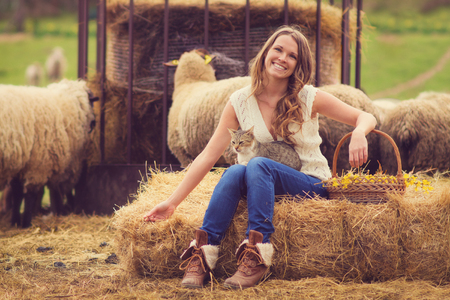 fodder: Young woman in the farm Stock Photo