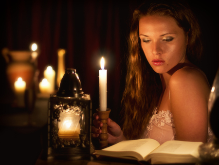 crimped: Women in candlelight Stock Photo