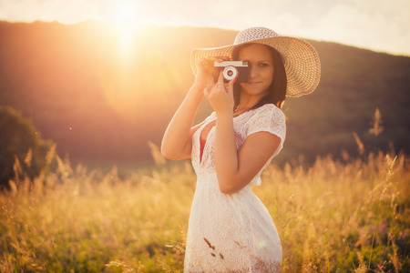 attractive  female: Attractive women with a vintage camera